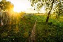 Paisaje rural hermoso en la puesta del sol Imagen de archivo libre de regalías