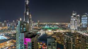 Paisaje urbano céntrico de Dubai con Burj Khalifa, timelapse de la antena de la demostración de la luz de LightUp almacen de video