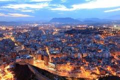 Paisaje urbano de Alicante en la noche Imagen de archivo libre de regalías