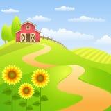 Paisajes de la granja con el granero y los girasoles rojos Imágenes de archivo libres de regalías
