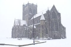 Paisley Abbey Cathedral Snow Covered White in Scottish Unexpected Harsh Weather. Paisley Abbey Historic Cathedral During Winter Covered Deep Snow in Town Centre Royalty Free Stock Image