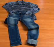 Paisley Dress Shirt and Blue Jeans Set Out to Wear Royalty Free Stock Image