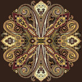 Paisley ethnic ornament. Circular abstract geometric paisley pattern. Traditional oriental ornament. Gold tones on brown background. Textile design Stock Image