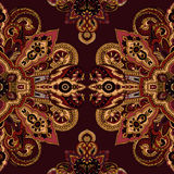 Paisley ornament background. Seamless abstract geometric paisley pattern. Traditional oriental ethnic ornament, burgundy red and gold tones. Textile design stock illustration