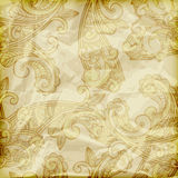 Paisley pattern  on crumpled foil texture Stock Image