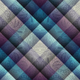 Paisley pattern on geometric background. Royalty Free Stock Images