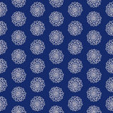Paisley pattern. Paisley seamless  pattern. Ethnic floral motif, primitive oriental flowers, dotted layout, ecru on blue background Royalty Free Stock Photos