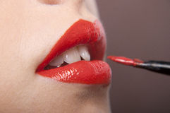 Paiting lips by brush Royalty Free Stock Images