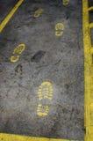 Paitned foot steps on industrial floor. Paitned foot steps on industrial floor Royalty Free Stock Image