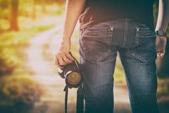 A paixão da pessoa da foto do dslr da câmera fotográfica do fotógrafo excede fotografia de stock royalty free