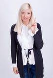 Paix femelle faisant des gestes avec la main, d'isolement sur le blanc Photographie stock libre de droits