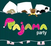 Pajama party. Girls at the party pajamas on the bed with pillows Stock Photography