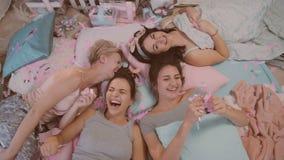 Pajama party. girls in pajamas having fun near a Christmas tree stock footage