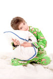 Pajamas. Little boy on his pajamas in bed isolated in white Stock Photos