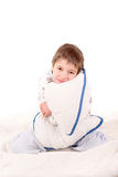 Pajamas. Little boy on his pajamas in bed isolated in white Stock Image