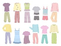 Pajamas for little girls. Set of pajamas for little girls in gentle colours isolated on white background Royalty Free Stock Photo