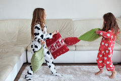 Pajamas party. Children in soft warm pajamas playing at home Stock Photography