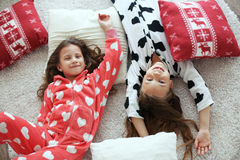 Pajamas party. Children in soft warm pajamas playing at home Royalty Free Stock Photos