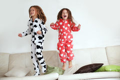 Pajamas party. Children in soft warm pajamas playing at home Stock Image