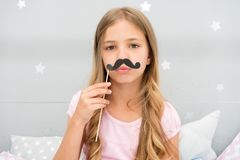Pajamas party concept. Girl fake mustache at pajamas party. Cheerful kid posing mustache. Photo booth props ideas. Printable accessories for party. Girl long stock images