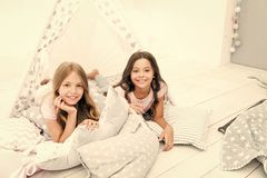 Pajamas party for kids. Siblings best friends. Sisters or best friends spend time together in bedroom. Girls having fun. Together. Girlish leisure. Sisters stock photos