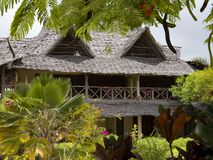 Beach house with thatched roof stock image