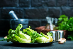 Pak choi. Fresh pak choi on plate and on a table Stock Photography