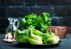 Pak choi. Fresh pak choi on plate and on a table Stock Photo