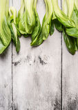 Pak choi  on white wooden background, top view Stock Images