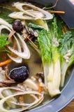 Pak Choy And Tea Tree Mushrooms Soup Stock Photo