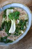 Pak choy soup. Pak choy Chinese cabbage soup with brown rice noodles royalty free stock photos