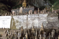 Pak Ou Caves - Buddha statues inside the lower cave Stock Photos
