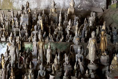 Pak Ou Caves - Hundreds of small wooden buddha figures inside the cave Royalty Free Stock Photo
