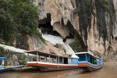 Pak Ou Caves - Tipical tourist boat along Mekong river. The boats waiting visitors of Pak Ou buddhist cave. Near to Luang Prabang in Laos Royalty Free Stock Image