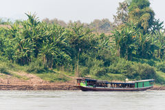 Pakbeng, Laos - Mar 03 2015: Slow boat cruise on the Mekong Rive. R. Popular tourist adventure trip by slow boat from Huay Xai to Luang Prabang stock photo