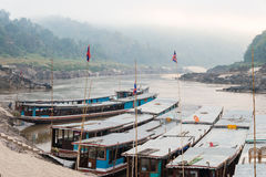 Pakbeng, Laos - Mar 04 2015: Slow boats at Mekong River in Pakbe Stock Images