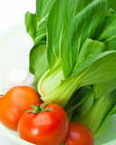 Pakchoi, garlic and tomato Royalty Free Stock Photography