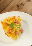 Paked pasta with ham, eggs Stock Photos