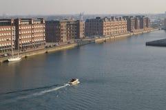 Pakhuskaj, Copenhagen. Aerial landscape view of river and buildings on shore, boat motoring down the river, Copenhagen, Denmark stock image