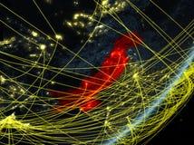 Pakistan auf dunkler Erde mit Netz lizenzfreie stockbilder
