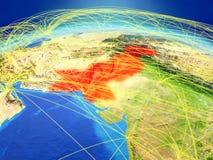 Pakistan auf Erde mit Netz lizenzfreie stockbilder