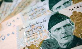 Pakistan Banknotes. A fan of 500 rupee banknotes from Pakistan showing the face of QuaideAzam Muhammad Ali Jinnah in national dress.Used banknotes photographed Stock Image