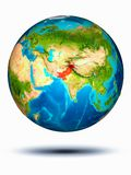 Pakistan on Earth with white background. Pakistan in red on model of planet Earth hovering in space. 3D illustration isolated on white background. Elements of stock photos