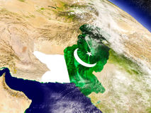 Pakistan with embedded flag on Earth Royalty Free Stock Images