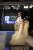Pakistan Fashion Design Council (PFDC) Fall Fashion Week 2012. Mehreen Syed, Pakistan top model walks on the ramp during the PFDC Fashion Week 2012 runway on the Stock Photos