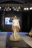 Pakistan Fashion Design Council (PFDC) Fall Fashion Week 2012. Mehreen Syed, Pakistan top model walks on the ramp during the PFDC Fashion Week 2012 runway on the Royalty Free Stock Images