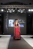 Pakistan Fashion Design Council (PFDC) Fall Fashion Week 2012. Mehreen Syed, Pakistan top model walks on the ramp during the PFDC Fashion Week 2012 runway on the Royalty Free Stock Photos