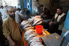 Pakistan fish seller Stock Photos