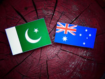 Pakistan flag with Australian flag on a tree stump isolated Royalty Free Stock Photo