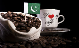 Pakistan flag in a bag with coffee beans  on black Royalty Free Stock Photography